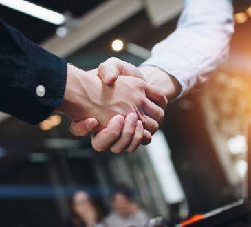 closeup of handshake in office