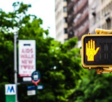 stop hand on pedestrian walk sign