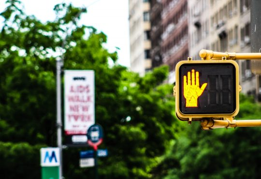 stop hand on pedestrian walk sign