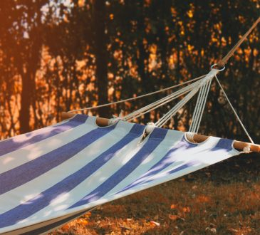 blue and white striped hammock outside