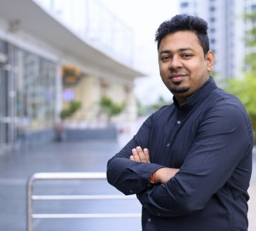 Portrait of young Indian man in black shirt in outdoor location