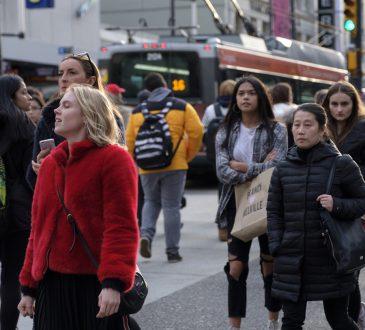 crowd walking on toronto street