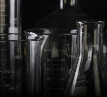 beakers against dark background