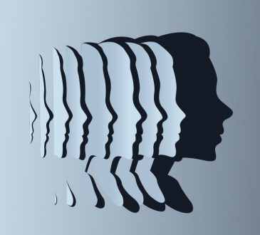 series of overlapping faces cut out of blue paper