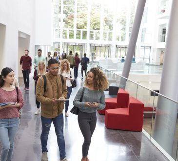 students walking in university building