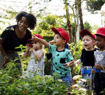 Teacher and kids learning gardening