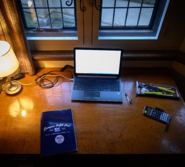 Student's desk with laptop at home.