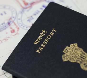 Close up of Indian passport stacked on white background.