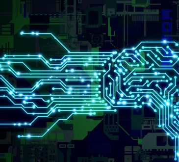 AI (Artificial Intelligence) concept. Human brain and circuit board.