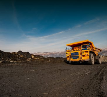 truck in an iron ore quarry transports raw materials.