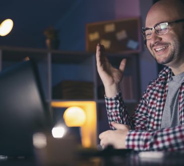 Man having a conference call using laptop computer.