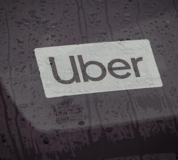 Uber sticker on windshield.