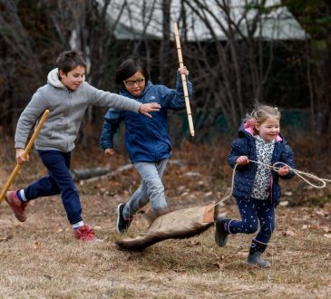 Grade 4 students from Elijah Smith Elementary School play traditional games at a salmon camp on Ta'an Kwach'an Council territory.