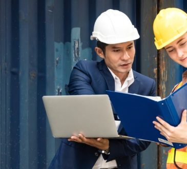 Man and woman in discussion on construction site.