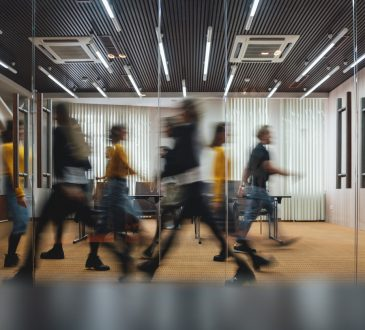 People walking quickly through office.
