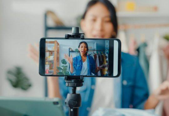 Woman filming herself talking on phone.