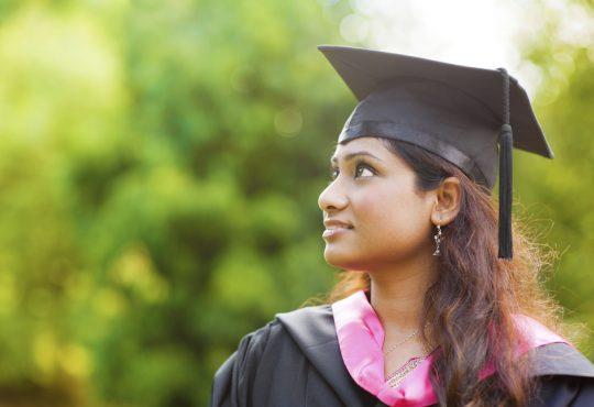Indian female student wearing graduation cap.