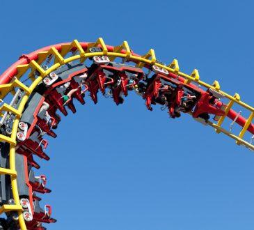 Rollercoaster loop against blue sky.