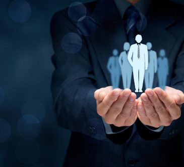 Photo illustration of business man with images of people sitting on hands
