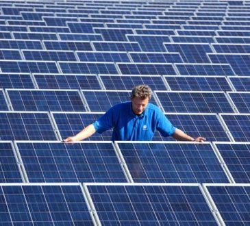 Man installing solar panels.