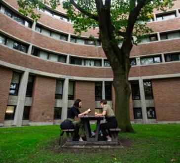 Students sitting outside on university campus.