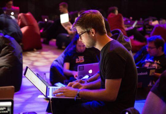 People working on laptops during hackathons.