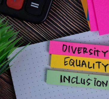 Diversity Equality Inclusion written on a sticky note on desk
