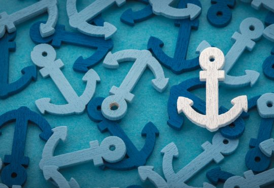 Background image of many blue and teal coloured anchors