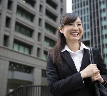 Businesswoman smiling and walking outside