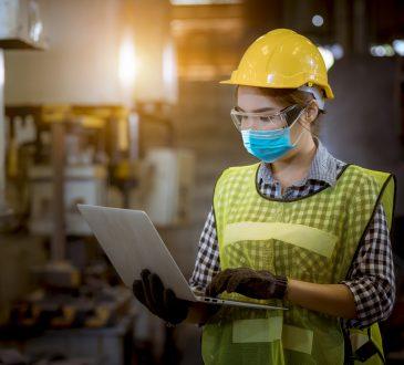 Woman engineer working in factory.