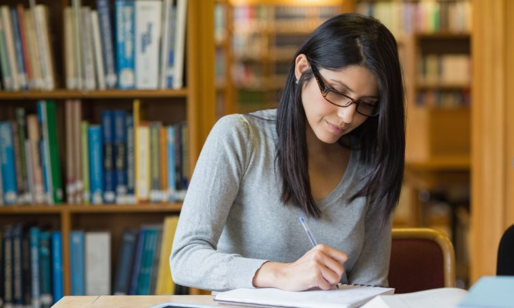Woman studying in the library